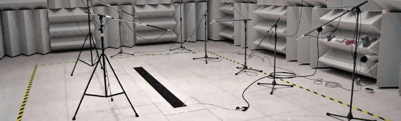 Experimental setup in the sound-chamber with built-in fan coil in the entrance area, microphones were placed in front of it